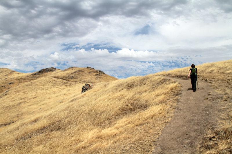 Hiking the ridgeline with big sky views.