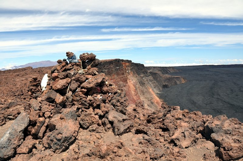 The Summit Cairn on Mauna Loa. An outline of distant Mauna Kea on the left horizon. with permission from Andrew Stehlik