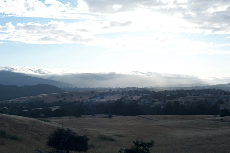 The trail as it descends towards Alpine Road and Interstate 280. Clouds roll along the hills, making for a great view.
