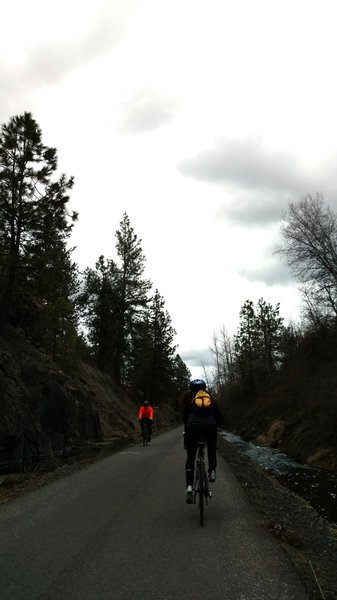 Cyclists passing along the trail.