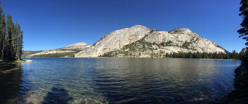 Breaks in the trees offer stunning views of the domes surrounding Tenaya Lake.