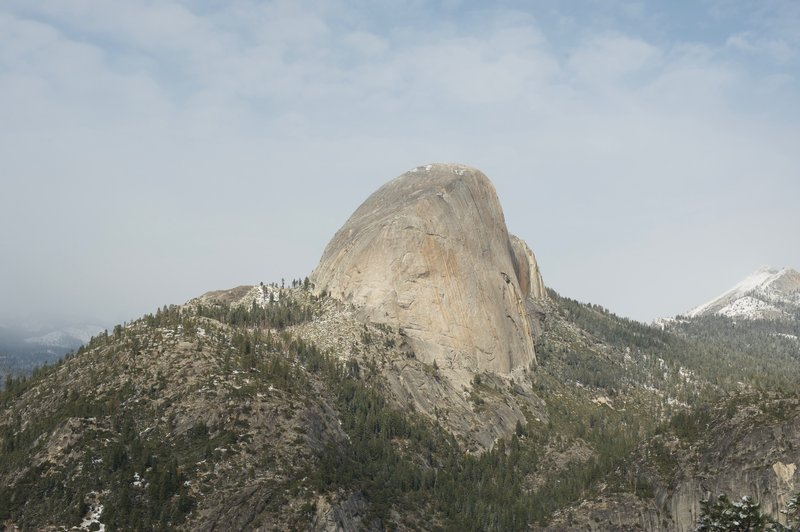 Half Dome looks very different from this viewpoint at Panorama Cliff.