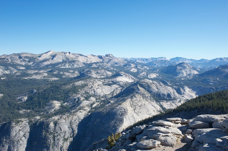 The granite domes of the high country.  You can see Tenaya Lake in the distance.