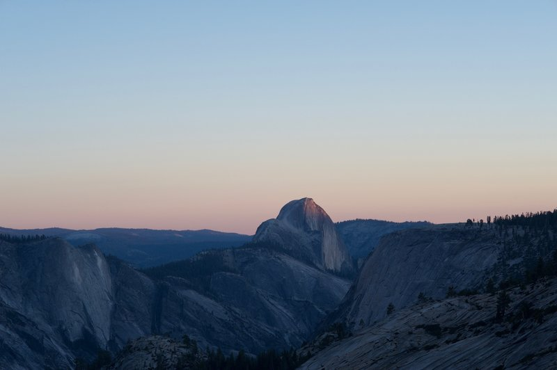 Quarter Domes and Half Dome at Sunset.   Olmsted Point is a great place to view the rock features of Tenaya Canyon and watch the sunset.