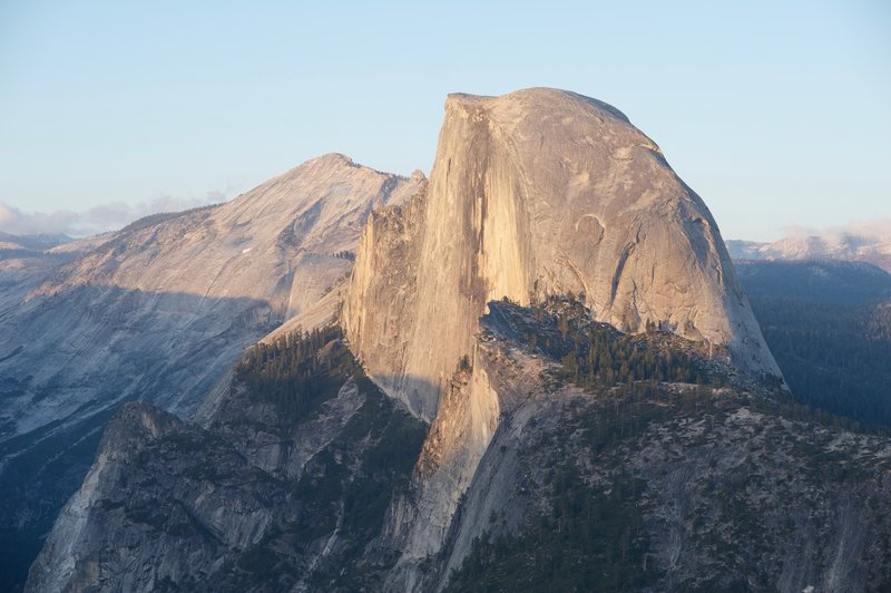 Half Dome at sunset.  The view from Glaciers Point at sunset is popular, especially in the summer. Make sure you get there early to find a spot.