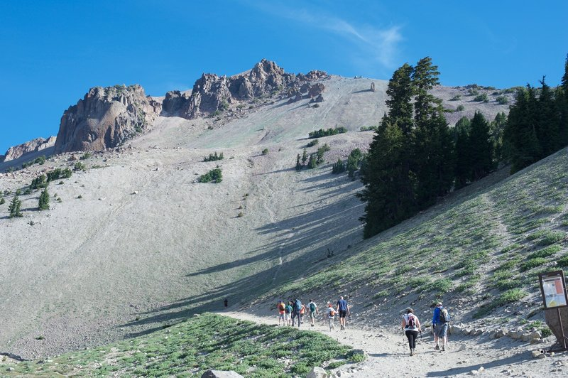 The Lassen Peak Trail as it leaves the parking lot. The trail switchbacks and starts climbing more steeply after the first turn.
