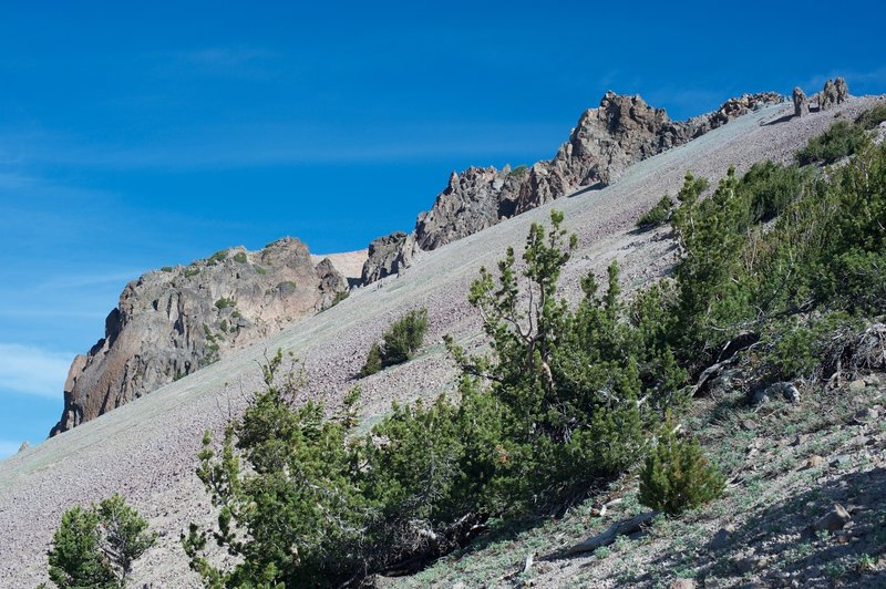 The side of Lassen Peak is made up of volcanic rock.  The large rock formations are called spines, formed when lab broke through the volcano's outer surface and pushed skyward.