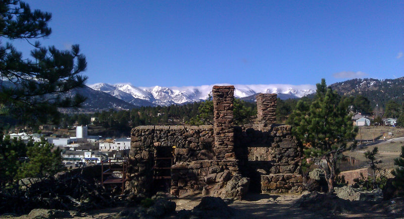 View of the Ruins, the Estes Park theater tower, and RMNP in the distance.