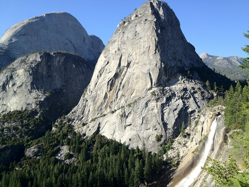 Nevada Falls and Liberty Cap loom over the trail.
