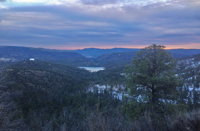 Grindstone Lake and the Ruidoso Valley just before dawn. Alfred Hale Connector is the perfect spot to watch the sun rise over the mountains.