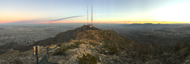 A panoramic view from the top of Directissimo. Ranger Peak Loop continues ahead towards the top of the Wyler Aerial Tramway, in the center of the picture. The southern suburbs of El Paso are visible beyond the mountains. Ciudad Juarez and the Sierra Madre range extend off into the distance.