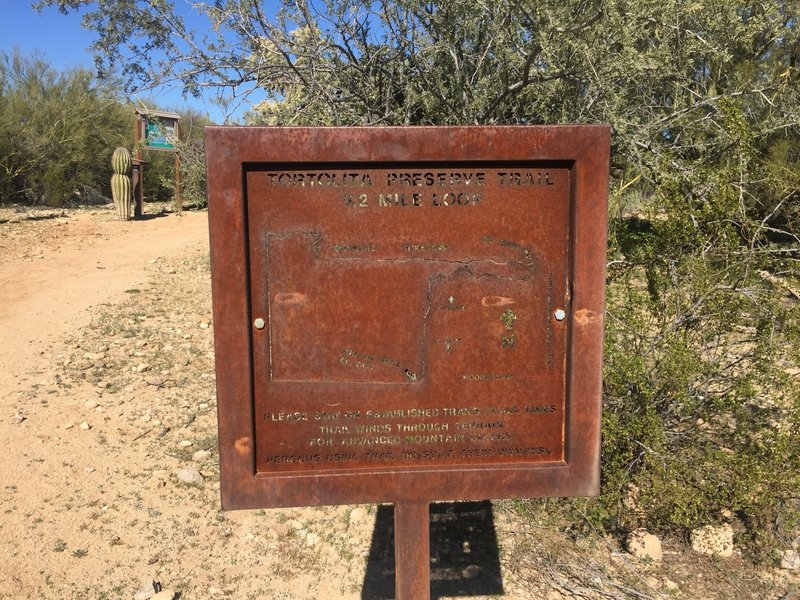 This sign lets you know you've found the trailhead.  The mileage here and throughout the trail does seem a bit short though compared with multiple GPS tracks.