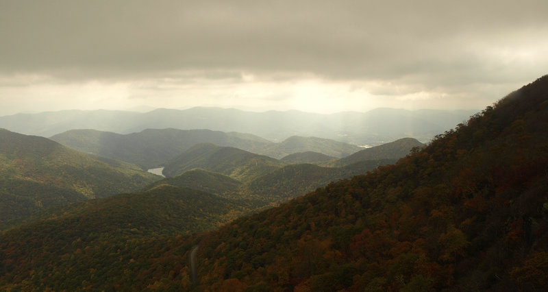 Sunlight filtering through clouds over Asheville, as seen from the Mountains-to-Sea Trail. Photo by Matt Mutel.