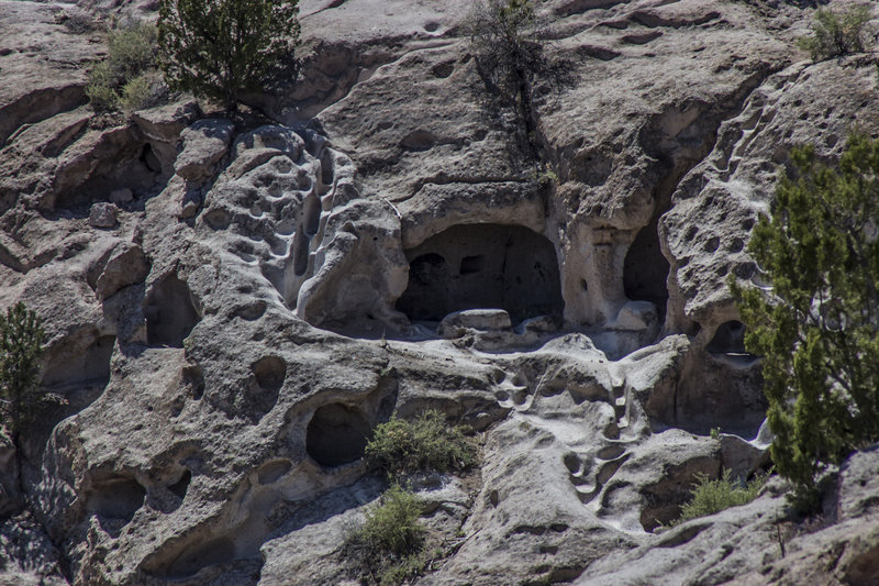 Often known as cliff dwellings, a cavate is a natural cave that has been enlarged or modified by humans. The soft rock found on the Pajarito Plateau made an ideal place for the Ancestral Pueblo people to thrive. Here, a cavate is surrounded by staircases and walkways carved out by footsteps.
