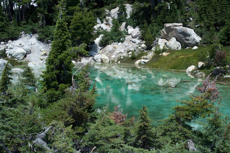 A clear, turquoise pool at the end of the boardwalk.