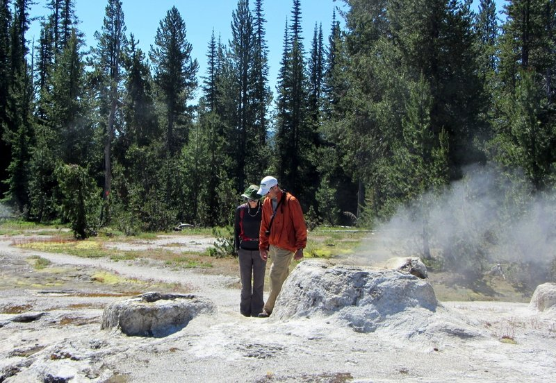 Union Geyser, with its three conspicuous cones, lies on the south end of the basin. Though its eruptions are rare, an occasional backpacker is treated to a spectacular sight. All three cones erupt simultaneously. The center cone sometimes reaches a height of over 100 feet.
