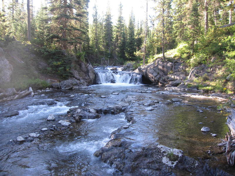 Scout Pool, a naturally heated swimming hole at the base of a small falls.