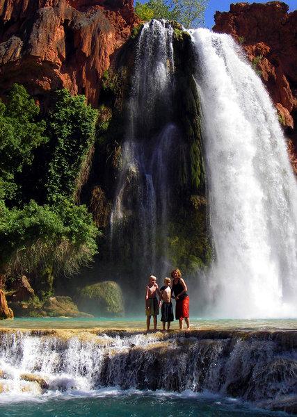 Visitors posing in front of Havasupai Falls.