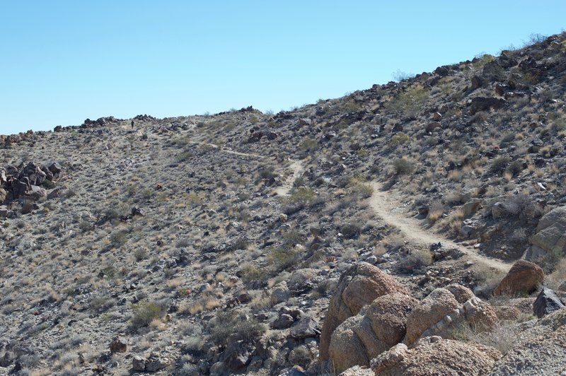 The trail as it climbs along the ridge line. It is narrow and exposed as it climbs the ridge.