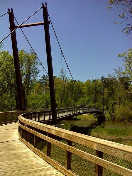 One of two suspension bridges across the Neuse River on MST Segment 11B. Photo by PJ Wetzel, www.pjwetzel.com.