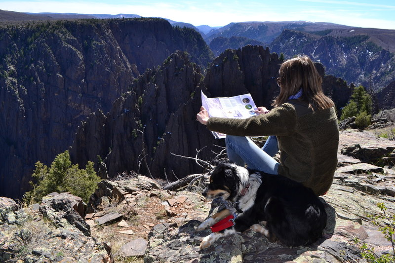 Kmeg and Millie hanging out on the rim of the Black Canyon of Gunnison.