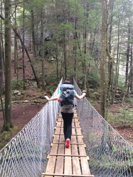 Crossing the bridge to the base of Foster Falls along the Fiery Gizzard Trail.