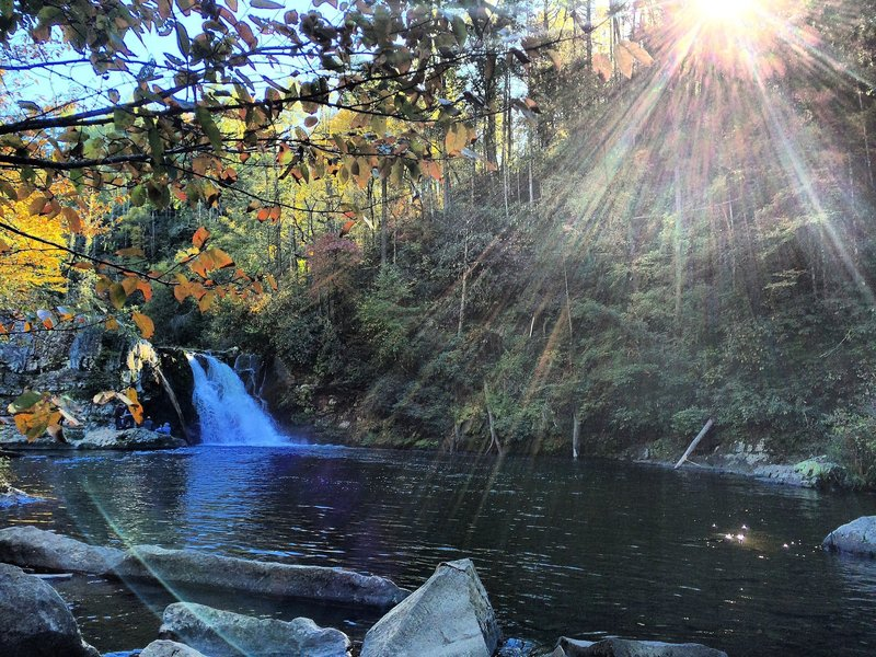 Sun shines on Abram Falls in the Great Smoky Mountains National Park.