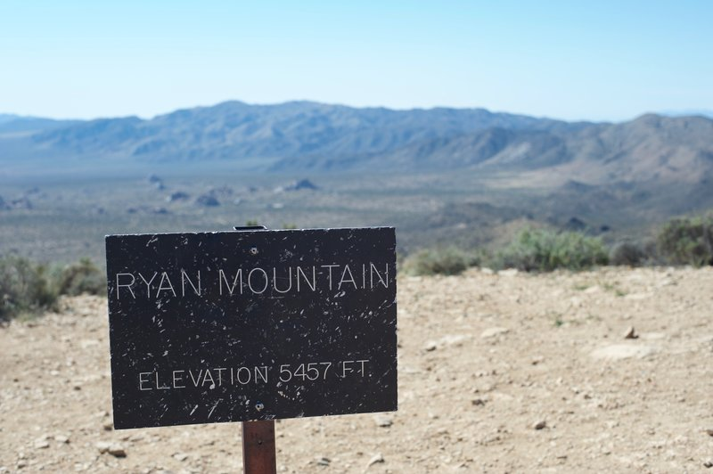The summit of Ryan Mountain is marked by a small sign. The rest of the park stretches out before you at this point.