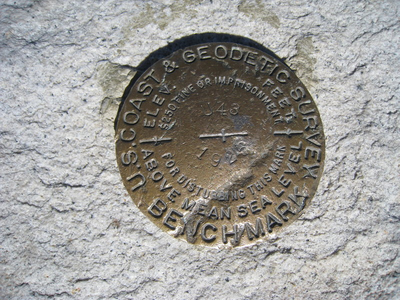 An iconic USGS marker awaits those who summit Mt. Whitney