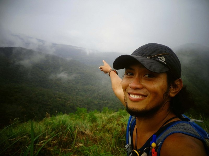 Standing at the Buko-buko sa Anay, pointing how far is the ridge...