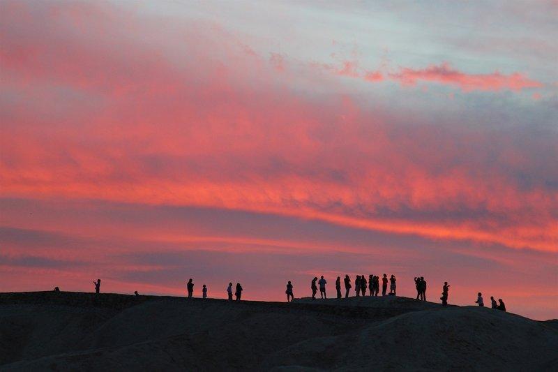 A large group enjoys a sunset.