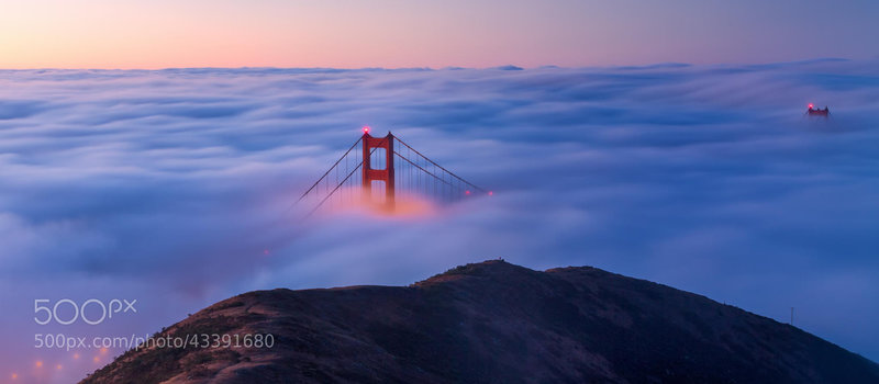 The Golden Gate Bridge shrouded in fog.