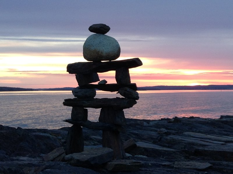 Inukshuk at sunset close to the William F. Schwartz Memorial Point along the Gaff Point Trail.