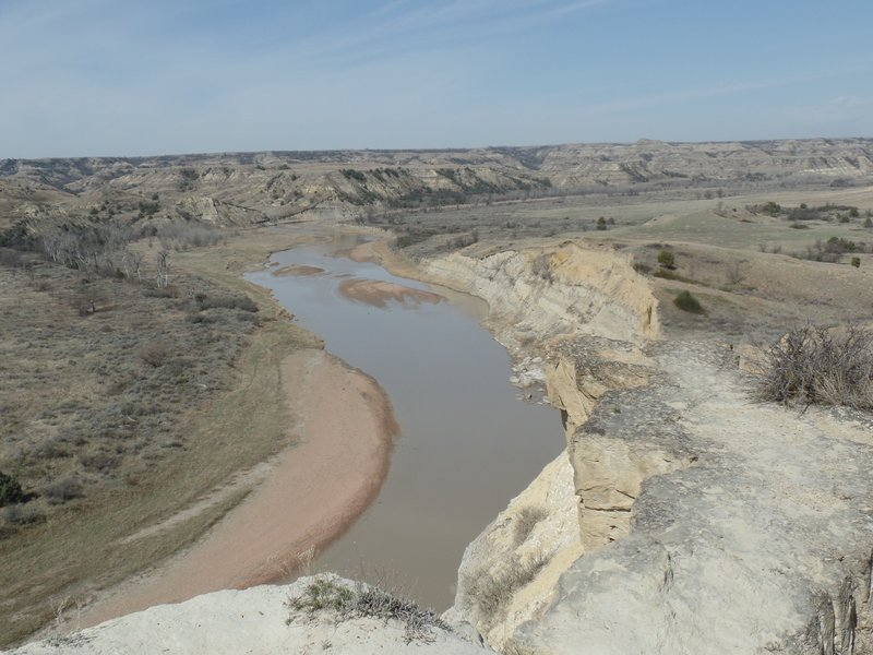 View of the Little Missouri River flowing north through the South Unit of the Theodore Roosevelt National Park.