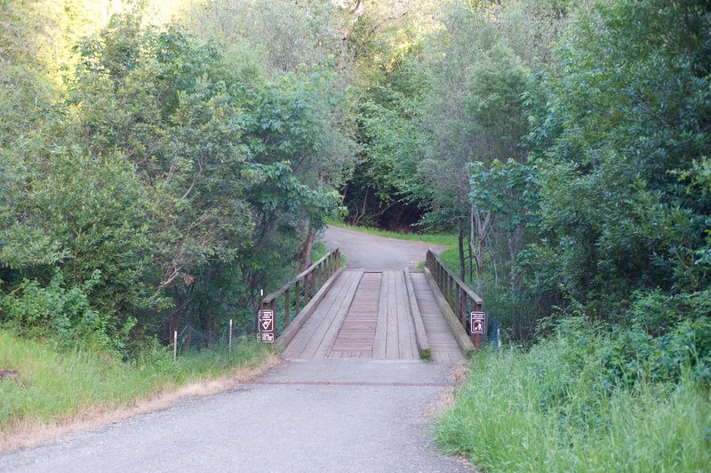 The bridge that leads to the trail from Alpine Road.