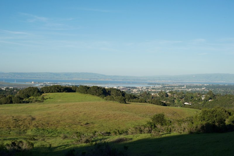 The trail begins to emerge from the woods and views of the San Francisco Bay area stretch before you.