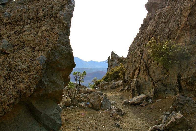"""Walking between """"Split Rocks"""" volcano rocks."""