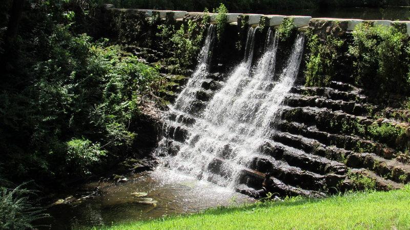 The old stone dam creates Ricks Pond.