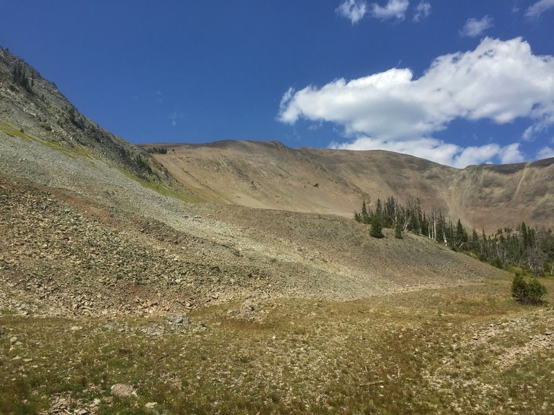 At the foot of a huge amphitheater-like bowl, the top of which is Avalanche Peak.