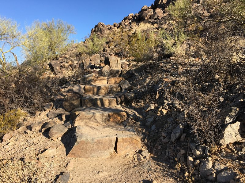 Short, but steep steps, leading to petroglyphs.