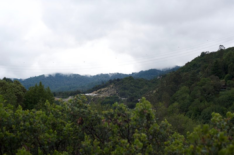A view of the surrounding hills as low hanging clouds hug the hilltops.