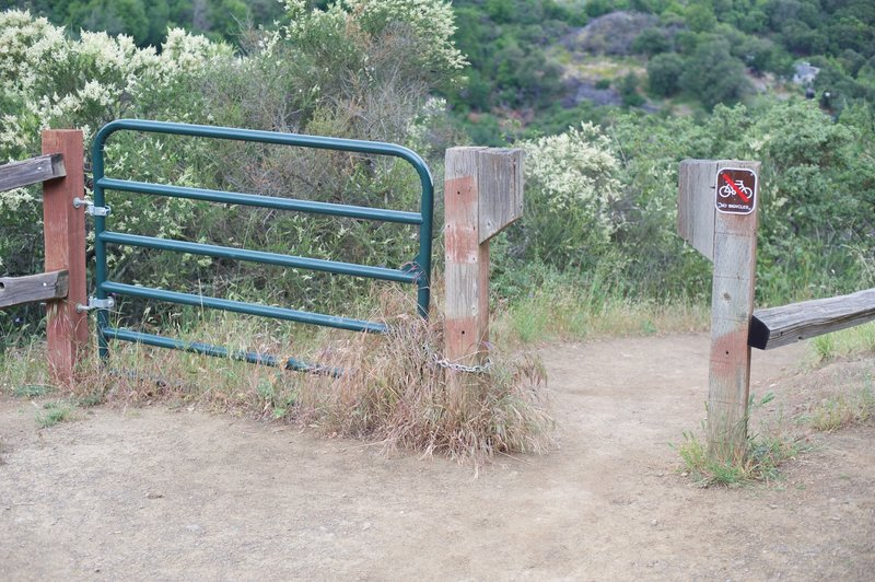 The trail passes through a gate that prevents horses and mountain bikers from accessing it.