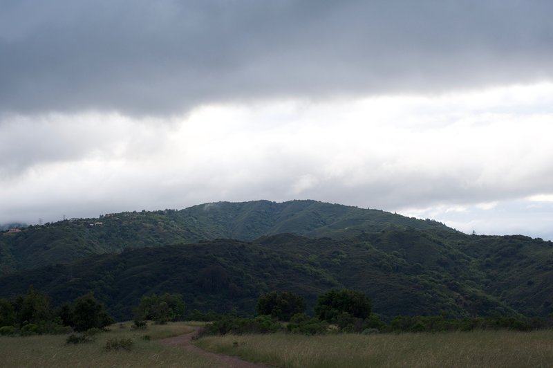 The trail as it makes its way along the hilltop and the surrounding hills.