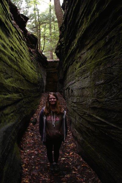 Between the rock cliffs.