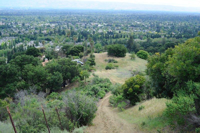 The trail descends a steep hill back toward civilization.