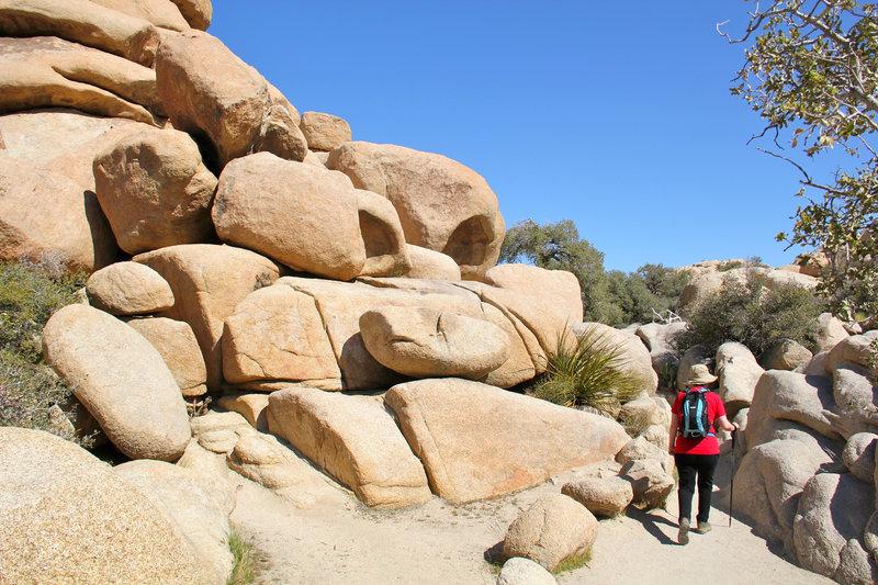 Walking through rock boulders.