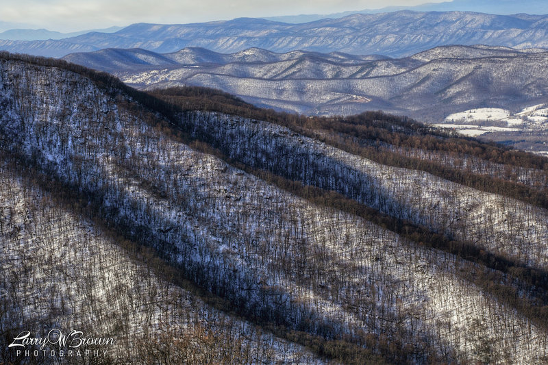 A winter afternoon view from Timber Hollow Overlook in the Central District .