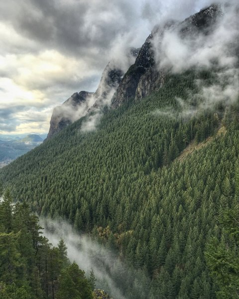 Little Si looking at Mt. Si through a break in the clouds.