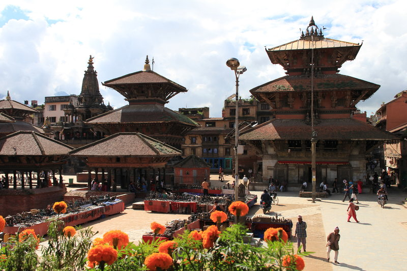 The picture is at Bhaktpur Durbar square in Nepal. It is historically royal palace of Nepal.