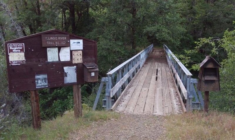 Briggs Creek bridge and Illinois River Trail #1161 trailhead. Permit boxes have no permits and no bottoms!